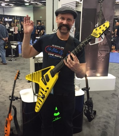 Yellow cut-out aluminium and composite guitar at NAMM.