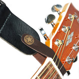 Acoustic Guitar Strap Button - Fretfunk - Strap button holding strap onto guitar