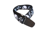 Fretfunk presents large white skulls on black guitar strap