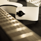 Ace of Spades Guitar Strap Locks - Fretfunk - showing black strap lock on white strap