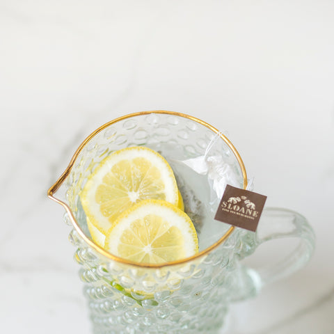 pitcher of marrakesh mint iced tea and lemon wheels