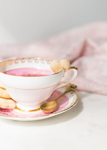 sugar heart on lip of china tea cup