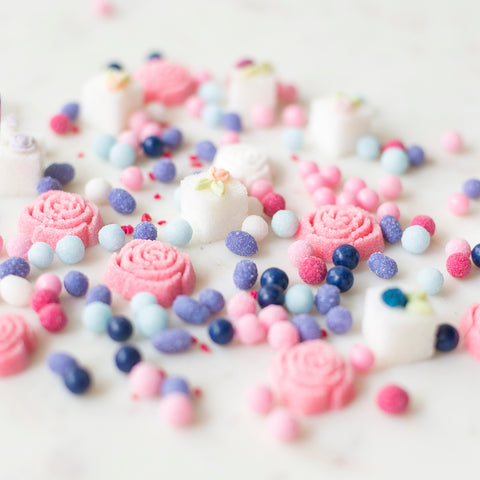 close up of colourful specialty sugar balls and roses