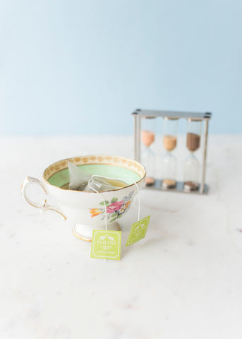 Jasmine Mist sachets steeping in cup with tea timer