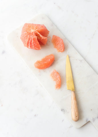 Peeled and sliced grapefruit wedges