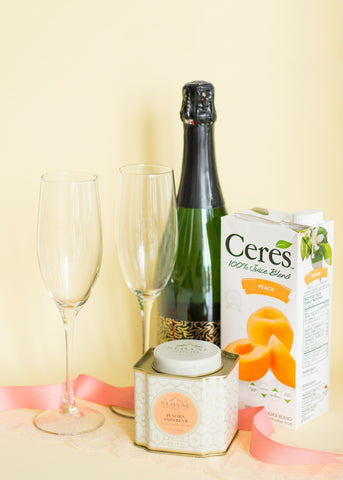tea tin, glasses, champagne and ribbon