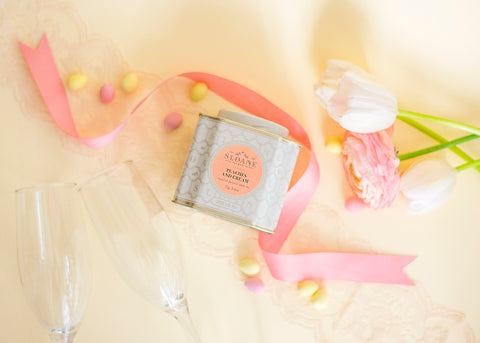 Peaches and Cream tin with florals and ribbon