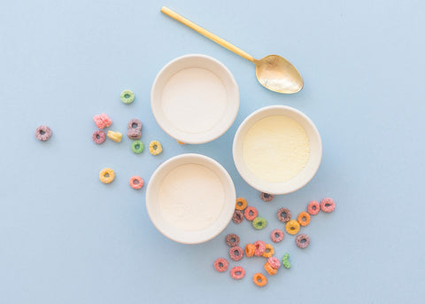 bowls of powder ingredients and crushed froot loops