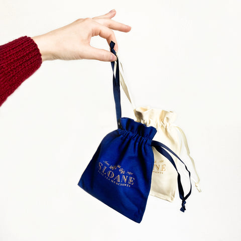 hand holding sloane suede pouches