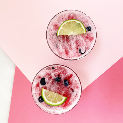 frozen crimson berry garnished in glasses