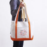 "Twist Long Handled Tote has the Wine Sisterhood ""Words"" Logo"