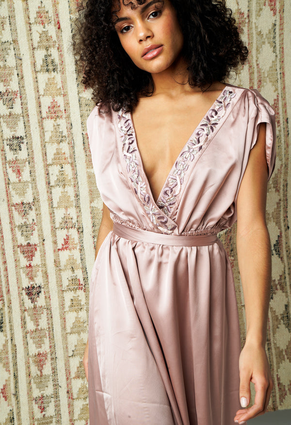 Evening dress in pearly pink silk embroidered and beaded by hand