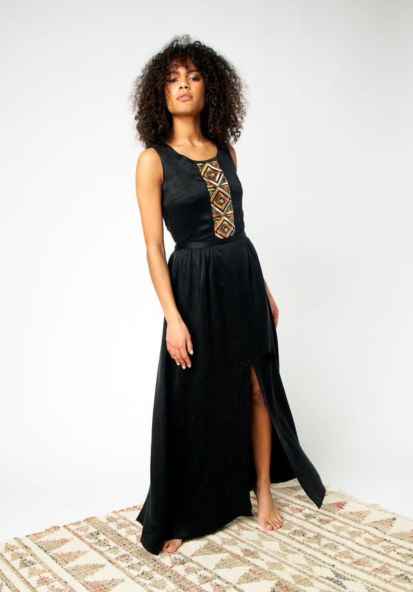 Evening dress in black silk embroidered and beaded by hand
