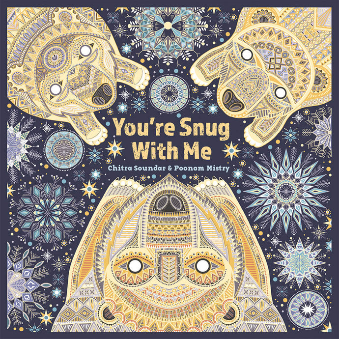 A family of polar bears are surrounded by snowflakes on the cover of children's book You're Snug With Me