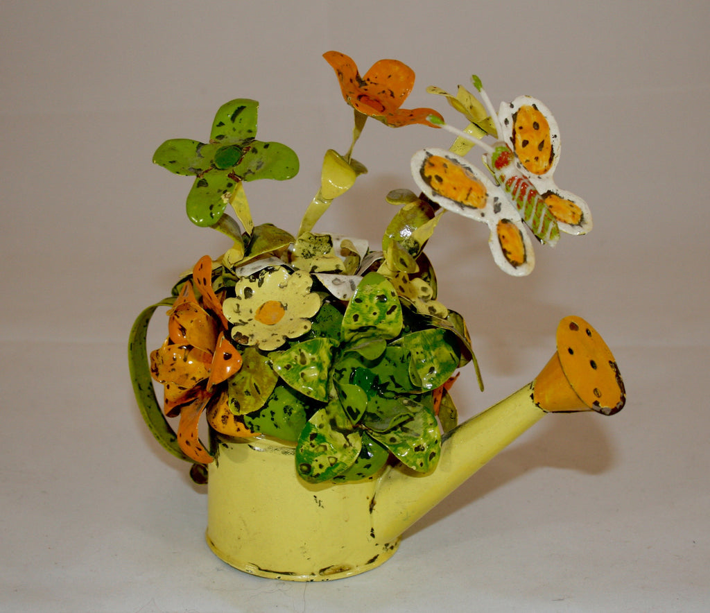 1960s metal watering can with flowers and butterfly
