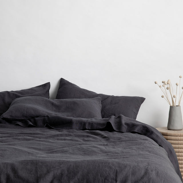 Bed styled with Slate Duvet Cover Set and Slate Sheet Set.