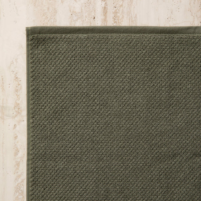 Close up of a corner of the Forest Bath Mat.