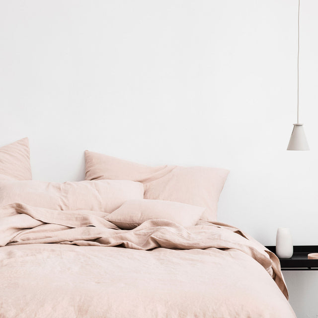 Bed styled with Blush Duvet Cover Set and Blush Sheet Set.