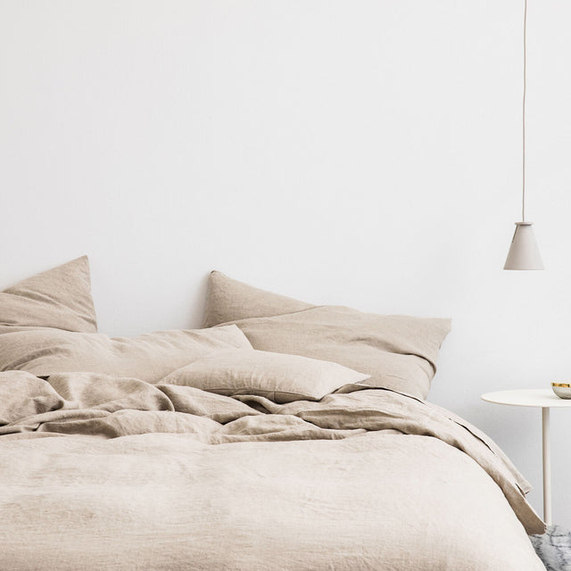 Bed styled with Natural Duvet Cover Set and Natural Sheet Set.