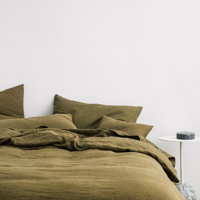 Bed styled with Olive Duvet Cover Set and Olive Sheet Set.
