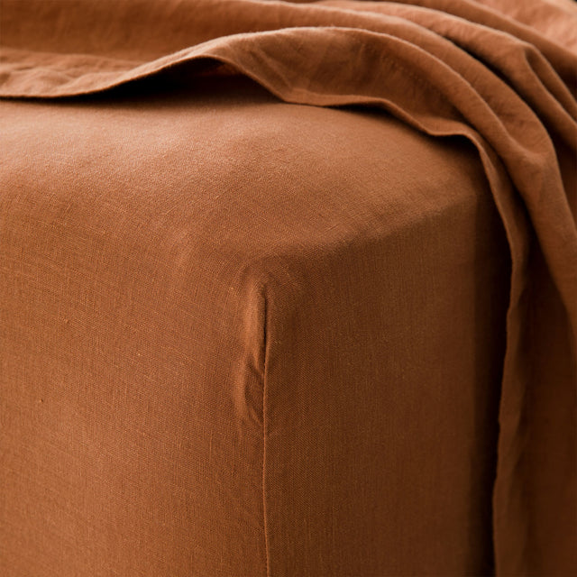 Close up of Linen Fitted Sheet in Cedar.