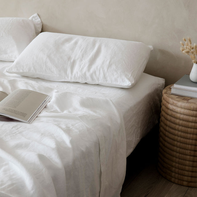 Bed with White Linen Sheets and Pillowcases