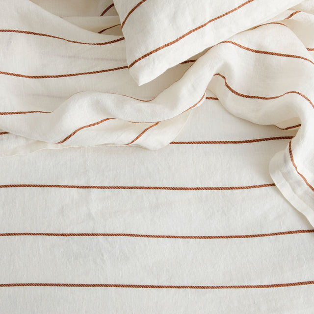 Detail of Linen Flat Sheet and Pillowcase in Cedar Stripe.