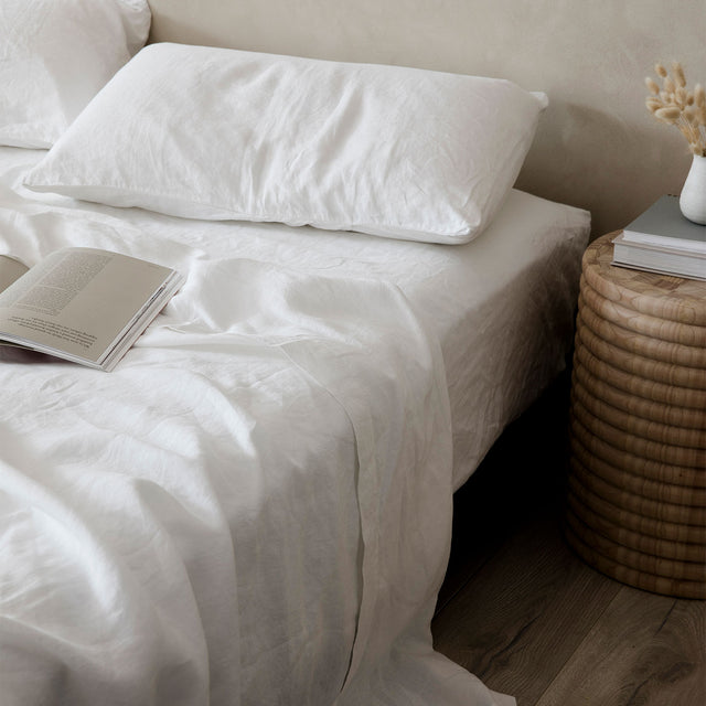 White Linen Sheets and Pillowcase on a Bed