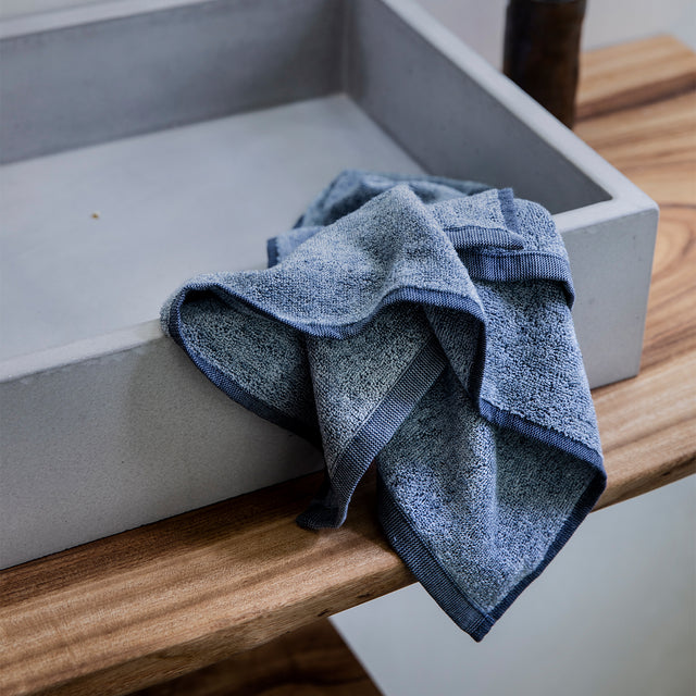 Denim hand towel on sink basin
