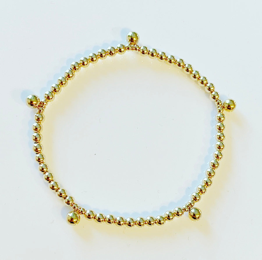 Gold Bracelet with Dangling Ball Details