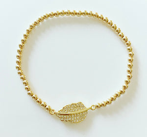Gold Bracelet with Feather Connector Charm