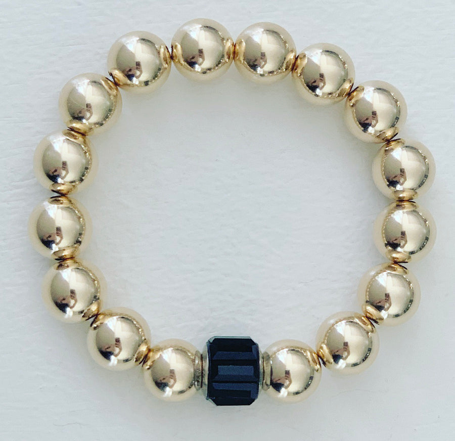 Jumbo 14K gold beads with black rondelle