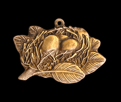 Brass Stamping of a small bird's nest to be used as a charm
