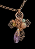 Necklace of a cross adorned by a Busy Bee Charm.