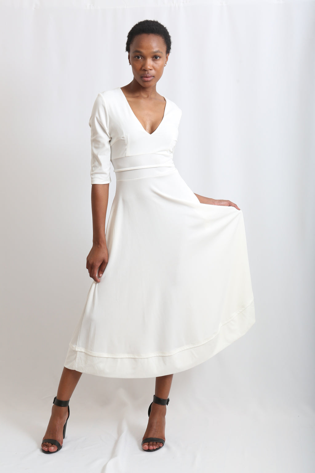 Deep Vneck maxi long dress cream or offwhite available in size small to xxxl in stretchable material at Zinhleolivia.com