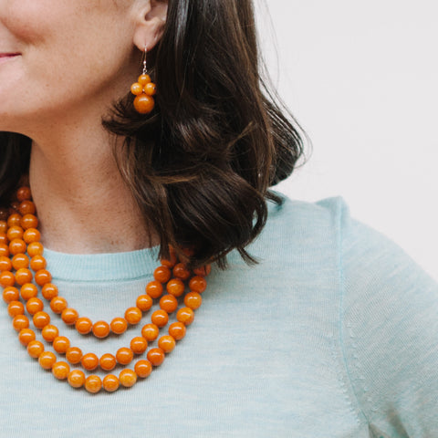Orange Amber Jade Jewelry on Model with Mint J.Crew Tippi Sweater