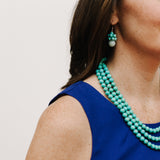 Mint Turquoise Silver Earrings on a Model with Blue Dress