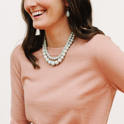 Pale Blue Amazonite Handmade Jewelry on a Model with Pink Sweater