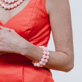 Light Pink Beaded Bracelets with Coral Orange Dress