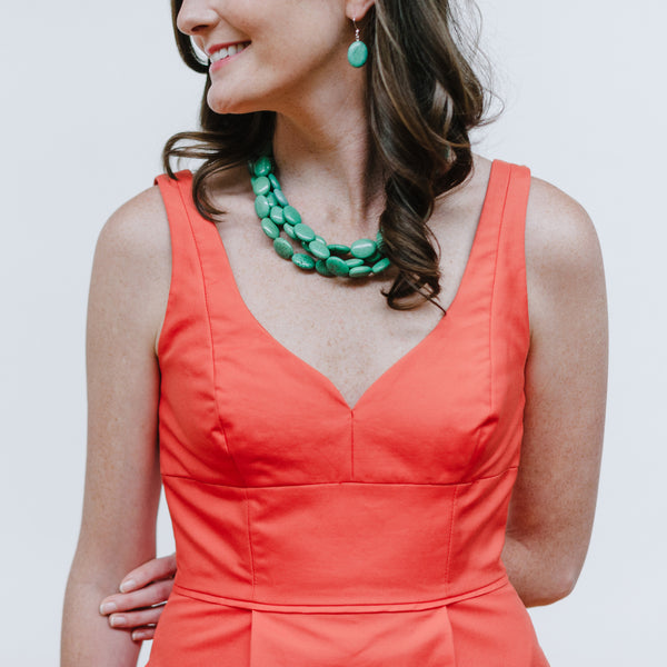 Orange Dress with Turquoise Torsade Necklace