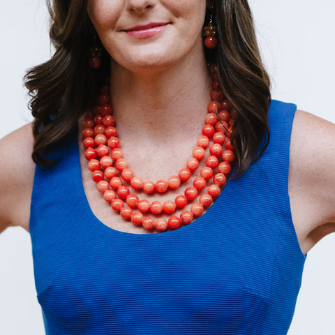 Coral Orange Statement Jewelry with Blue Dress