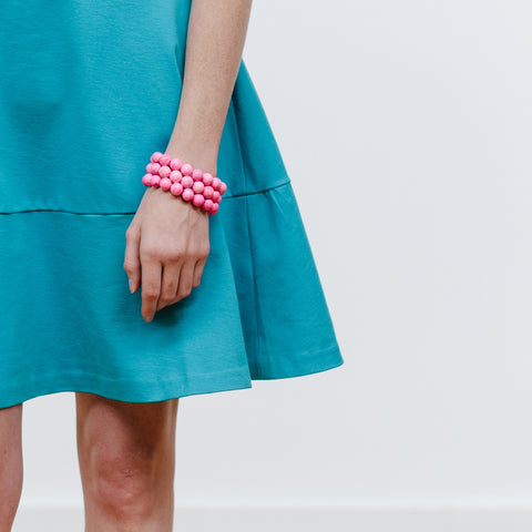 Turquoise Dress and Pink Bracelets