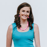 Hot Pink Jewelry with Blue Green Dress