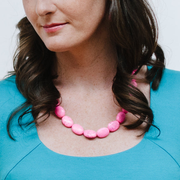 Pink Necklace and Turquoise Dress