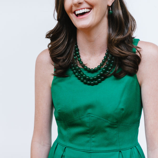 Green Dress with Green Statement Jewelry