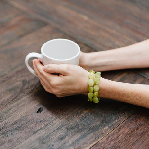 Green Bracelet with Brown Wood Table