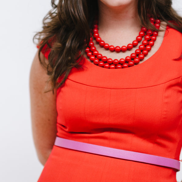 Red Dress with Red Statement Necklace and Pink Belt