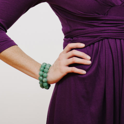 Purple Wrap Dress with Sage Green Jewelry