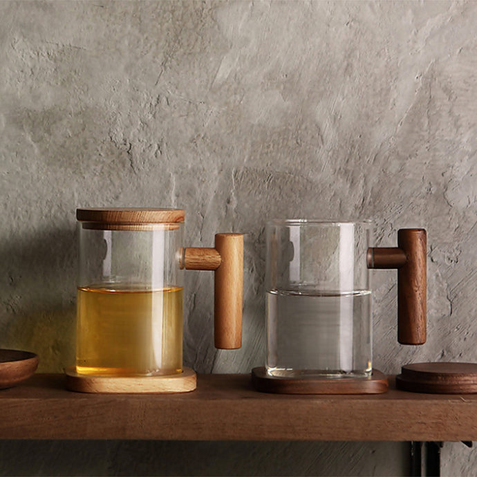 High quality borosilicate glass 3 piece tea cup with natural untreated wooden handle, lid and coaster.    The wooden handle is gently rounded and feel nice in your hand. The easy to grip handles makes you feel comfortable while using it.  Perfect for your hot tea whether at home or in the office. Makes a perfect gift to loved ones.  Borosilicate glass is known for its durability and heat resistance.   Suitable for your daily green tea, black tea, floral tea, chinese tea or fruit tea.