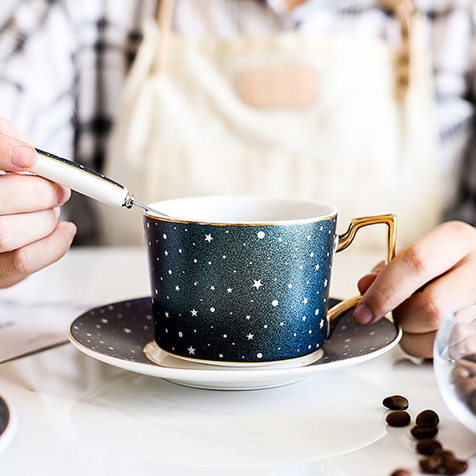 This ceramic cup and saucer set come with a matching spoon for the cosmic lover perfect for your coffee or tea drinking.